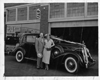 1936 Packard club sedan, parked in front of Packard service department