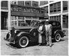 1936 Packard sedan in front of Packard plant, Donderos standing by driver