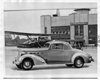 1936 Packard sport coupe parked in front of Detroit City Airport