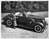 1936 Packard convertible coupe, top folded, female driver and passenger