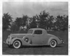 1936 Packard coupe, nine-tenths left side view, parked on grass