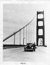 1937 Packard sedan, parked on the almost completed Golden Gate Bridge