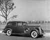1937 Packard touring sedan, nine-tenths right front view, parked on street