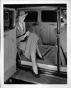 1937 Packard touring sedan, view of rear interior from right, woman stepping out of rear