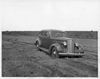 1937 Packard touring sedan in dirt field at Packard Proving Grounds