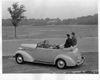 1937 Packard convertible sedan, couple sitting on folded top at Belle Isle