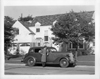 1937 Packard touring sedan parked on street in front of house