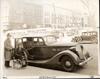 1937 Packard touring sedan, owner Mrs. Martin Johnson at passenger door