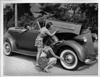 1937 Packard convertible victoria examined by bathing beauties