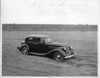 1937 Packard club sedan parked in dirt field at Packard Proving Grounds