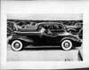 1938 Packard convertible victoria, left side view, top folded, Alvin Macauley, Jr. behind wheel