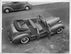 1938 Packard convertible sedan parked on street, view from above