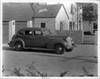 1938 Packard touring sedan parked in driveway of house