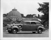 1938 Packard touring sedan parked in front of Belle Isle conservatory