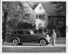 1938 Packard touring sedan, right side view, parked in driveway of Alvan Macauley