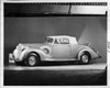1938 Packard coupe roadster, nine-tenths left side view, top raised, rumble seat open