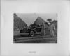 1939 Packard touring sedan in front of pyramids with two men and camels