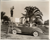 1939 Packard convertible coupe in California with bathing beauties posing for photographer
