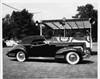1942 Packard convertible victoria parked on grass by viewing stand