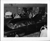 1951 salon showing a 1951 Packard 4-door sedan, crowd surrounding car