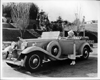 1932 Packard sport phaeton and owner actress Jean Harlow leaning on open driver