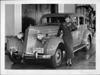 1935 Packard sedan with Miss Jean Parker in Packard dealer showroom
