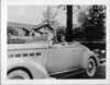 1936 Packard convertible coupe with Dixie Dunbar waving behind wheel