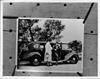 1936 Packard touring sedan, Onslow Stevens assisting Evalyn Knapp