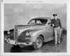 1946-47 Packard touring sedan, owner General Arnold standing at driver