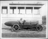 Packard 299 race car, left side view, two men inside