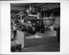 Packard factory assembly line, body dropping from above, worker on either side