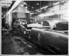 1955 Packard Clipper metal bodies on assembly line, entering spraying tunnel