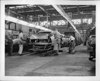 1956 Packard metal bodies on assembly line, entering spraying tunnel