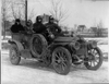 1908 Packard model U test car covered in mud with four male passengers