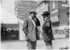 Two men talking near inspection tent, 1909 automobile parade, Detroit, Mich.