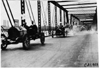 Chalmers cars crossing bridge in 1909 Glidden Tour automobile parade, Detroit, Mich.