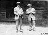 Two men on dock, 1909 Glidden Tour, Detroit, Mich.
