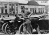 Man leaning against car, 1909 Glidden Tour, Detroit, Mich.