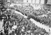 Crowd lining street for start of 1909 Glidden Tour, Detroit, Mich.