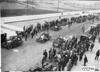 Crowd of men gather to watch arrival of Glidden tourists in Chicago, Ill. at 1909 Glidden Tour