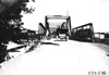 Press car going over Sauk City, Wis. bridge at 1909 Glidden Tour