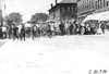 Crowd surrounds Glidden tourists in Rochester, Minn. at the 1909 Glidden Tour