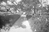 Rural road with houses en route to Minneapolis, Minn., at the 1909 Glidden Tour