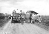 Premier car stopped in middle of road, en route to Minneapolis, Minn., at the 1909 Glidden Tour