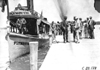 """Smithson with megaphone on board """"Plymouth,"""" at 1909 Glidden Tour"""