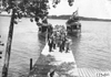 Glidden tourists disembark Plymouth and Puritan excursion boats, at 1909 Glidden Tour