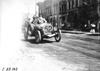 Jean Bemb in Chalmers car passing through Faribault, Minn., at 1909 Glidden Tour