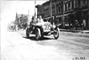 John Machesky in Chalmers car passing through Faribault, Minn., at 1909 Glidden Tour