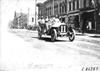 Gus Buse in Thomas car passing through Faribault, Minn., at 1909 Glidden Tour