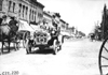 Glidden tourists in Maxwell car passing through Madison Lake, Minn., at 1909 Glidden Tour